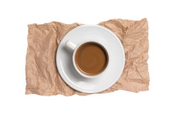 Coffee cup. On recycled brown paper isolated on white Stock Images