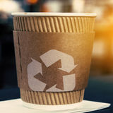 Coffee cup with recycling sign Royalty Free Stock Images