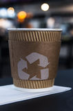 Coffee cup with recycling sign Royalty Free Stock Image