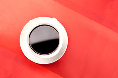 Coffee cup on red Royalty Free Stock Images