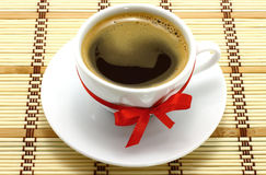 Coffee cup with red bow Stock Photography