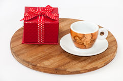 Coffee cup and red box with a bow Stock Photos