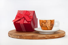 Coffee cup and red box with a bow Royalty Free Stock Photography