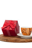 Coffee cup and red box with a bow Royalty Free Stock Images