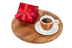 Coffee cup and red box with a bow Stock Image