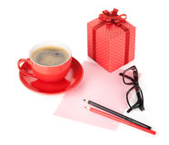 Coffee cup, red gift box and office supplies Stock Photography