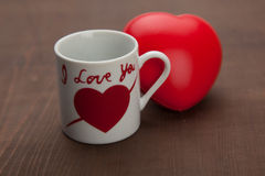 Coffee cup and red heart Stock Images
