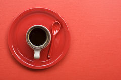 Coffee cup on red table Royalty Free Stock Photos