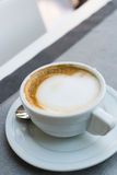 Coffee cup on restaurant table Stock Image