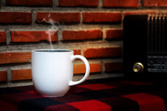 Coffee cup and Retro radio on  table Stock Photo