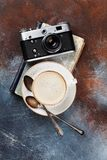 Coffee cup and retro camera. Over book. Top view Royalty Free Stock Photo