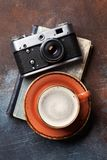 Coffee cup and retro camera. Over book. Top view Royalty Free Stock Images