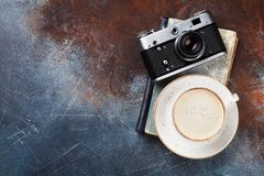 Coffee cup and retro camera. Over book. Top view with space for your text Royalty Free Stock Images