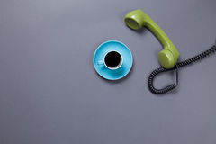 Coffee cup and retro dial phone Royalty Free Stock Image