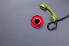 Coffee cup and retro dial phone Stock Image