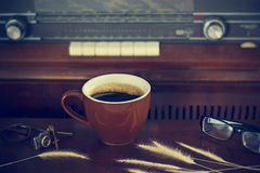 Coffee cup and retro radio background Stock Image