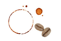 Coffee cup rings and coffee beans isolated on a white background Royalty Free Stock Images