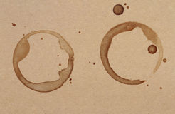 Coffee cup rings stains on a brown paper texture Royalty Free Stock Photo