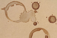 Coffee cup rings stains on a brown paper texture Stock Photography