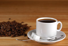 Coffee cup and roasted beans Stock Photos