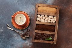 Coffee cup, roasted beans and brown sugar stock photos