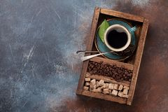 Coffee cup, roasted beans and brown sugar royalty free stock image