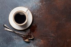Coffee cup, roasted beans and ground coffee stock photo