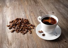 Coffee cup with roasted beans Royalty Free Stock Photos