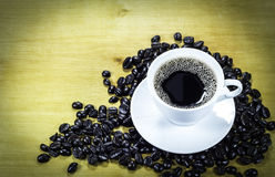 Coffee cup and roasted beans Royalty Free Stock Images