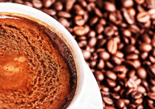 Coffee cup with roasted coffee beans may use as background Stock Image