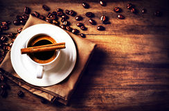 Coffee cup and roasted coffee beans  on wooden  brown background Royalty Free Stock Image