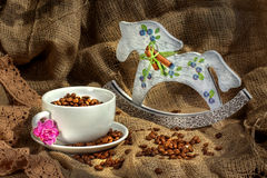 Coffee cup and rocking horse Royalty Free Stock Photo