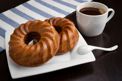 Coffee cup, round cake on table Royalty Free Stock Photo