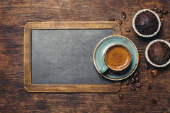 Coffee cup. Rustic background with vintage blackboard  and coffee cup Stock Photo