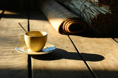 Coffee cup on rustic table Stock Images