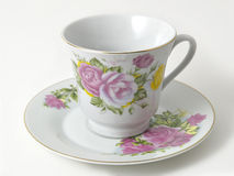 Coffee Cup & Saucer. Decorative coffee cup and saucer on a white background royalty free stock photography