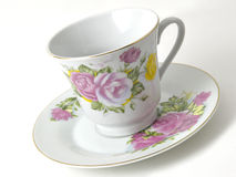 Coffee Cup & Saucer. Tilted fancy coffee cup and saucer on a white background royalty free stock photos