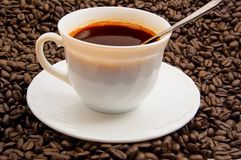 Coffee Cup and Saucer. On coffee beans background Royalty Free Stock Photo
