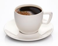 Coffee cup and saucer. On a white background Stock Photography