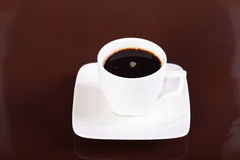 Coffee cup and saucer on background Royalty Free Stock Photography