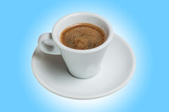 Coffee cup and saucer on a blue background Royalty Free Stock Images