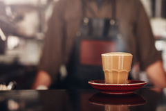 Coffee cup with saucer on cafe counter Stock Images