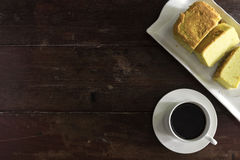 Coffee cup and saucer with cake Royalty Free Stock Image