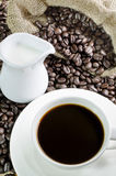 Coffee cup and saucer with coffee bean Royalty Free Stock Images