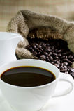Coffee cup and saucer with coffee bean Stock Photo