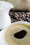 Coffee cup and saucer with coffee bean Stock Images
