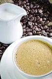 Coffee cup and saucer with coffee bean Stock Photos