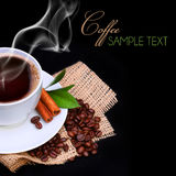 Coffee cup with saucer and coffee beans on burlap Royalty Free Stock Images