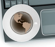 Coffee cup and saucer with a globe on computer keyboard Stock Photography