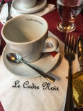 Coffee cup and saucer at Le Cadre Noir, Paris restaurant Royalty Free Stock Images